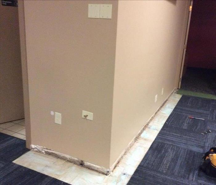 Water Damage. Working around busy lobby. Before