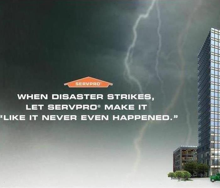 black, grey, and white background with a lightning bolt and tall skyscraper to the right. SERVPRO house with words under it.