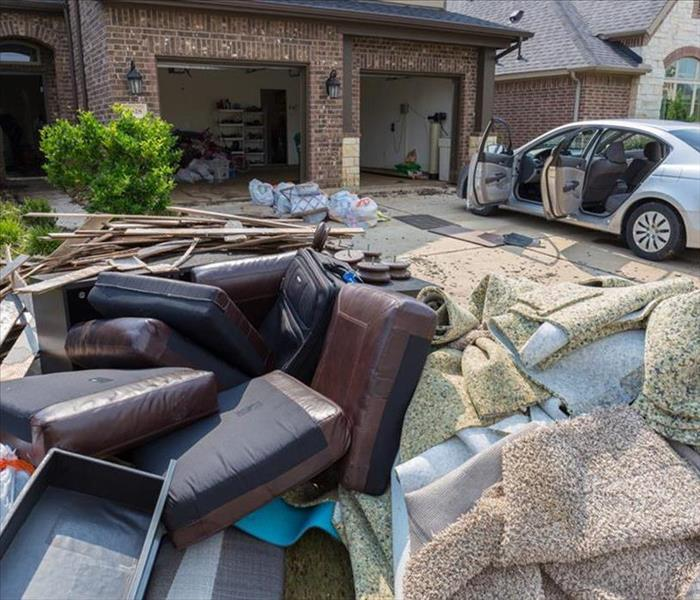 House damaged from hurricane, property contents on lawn